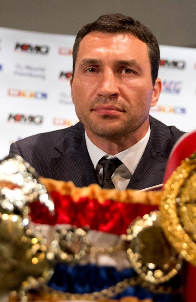 IBF , WBO-  WBA heavyweight boxing  world champion, Ukraine's Wladimir Klitschko  poses with his belts at  a press conference in Hamburg, northern Germany, Wednesday June 25, 2014.  Klitschko will face Bulgaria's Kubrat Pulev in a  title bout on Sept. 6, 2014 in Hamburg