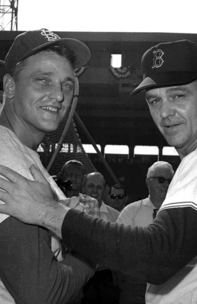 In this Oct. 5, 1967, file photo, Boston Red Sox manager Dick Williams, right, poses with St. Louis Cardinals' Roger Maris before Game 2 of the World Series in Boston. The World Series starts in Boston on Wednesday, Oct. 23, 2013, when the Red Sox will play the Cardinals in a rematch of the 1946, 1967 and 2004 Series