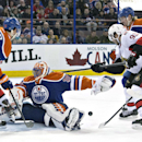 Ottawa Senators' Mika Zibanejad (93) is stopped by Edmonton Oilers goalie Ben Scrivens (30) as Justin Schultz (19) and Jeff Petry (2) defend during the first period of an NHL hockey game, Tuesday, March 4, 2014 in Edmonton, Alberta The Associated Press