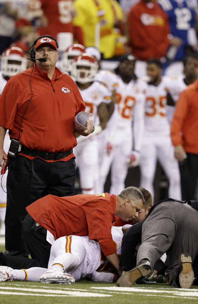 Kansas City Chiefs running back Jamaal Charles (25) is looked at by trainers after going down against the Indianapolis Colts during the first half of an NFL wild-card playoff football game Saturday, Jan. 4, 2014, in Indianapolis