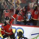 Calgary Flames' Jiri Hudler, from the Czech Republic, celebrates his goal during second period NHL hockey action against the Boston Bruins in Calgary, Alberta, Tuesday, Dec. 10, 2013 The Associated Press