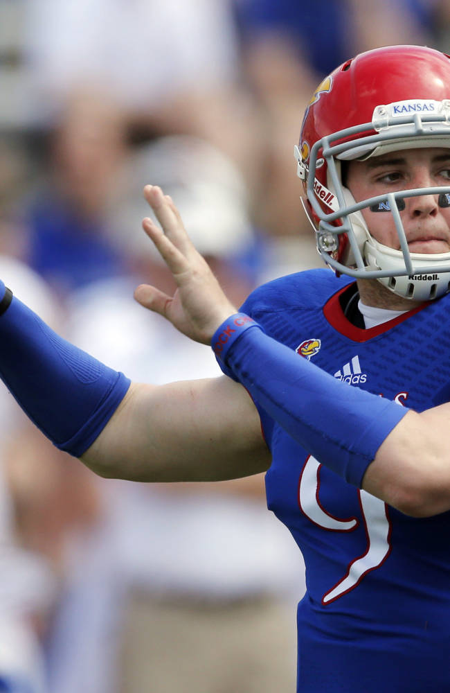 Kansas quarterback Jake Heaps passes to a receiver during the second half of an NCAA college football spring game in Lawrence, Kan., Saturday, April 12, 2014