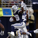 In this Sept. 21, 2014, file photo, Dallas Cowboys running back DeMarco Murray, top, carries the ball after catching a pass for a 6-yard gain as St. Louis Rams cornerback E.J. Gaines (33) defends during the second quarter of an NFL football game in St. L