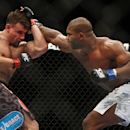 Frank Mir [L] absorbs a punch from Alistair Overeem at UFC 169 (AP)