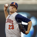 Illinois pitcher John Kravetz (23) pitches to Michigan State in the first inning of a third-round NCAA Big Ten tournament college baseball game Friday, May 22, 2015, in Minneapolis. (AP Photo/Bruce Kluckhohn)