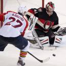Florida Panthers center Nick Bjugstad, left, tries to put the puck past Ottawa Senators goalie Craig Anderson during second-period NHL hockey game action on Thursday, Dec. 19, 2013, in Ottawa, Ontario. (AP Photo/The Canadian Press, Adrian Wyld)