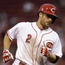 Cincinnati Reds' Zack Cozart rounds the bases after hitting a solo home run off Pittsburgh Pirates starting pitcher Francisco Liriano in the fourth inning of a baseball game, Monday, June 17, 2013, in Cincinnati. (AP Photo/Al Behrman)