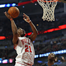 CHICAGO, IL - FEBRUARY 27: Jimmy Butler #21 of the Chicago Bulls puts up a shot over Andrew Wiggins #22 of the Minnesota Timberwolves on his way to a game-high 28 points at the United Center on February 27, 2015 in Chicago, Illinois. The Bulls defeated the Timberwolves 96-89. (Photo by Jonathan Daniel/Getty Images)