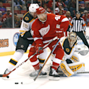 Detroit Red Wings right wing Luke Glendening (41) tries to skate as Boston Bruins defenseman Kevan Miller (86) and Boston Bruins goalie Tuukka Rask (40), of Finland, defend in the second period of a NHL hockey game in Detroit Thursday, Oct. 9, 2014 The As