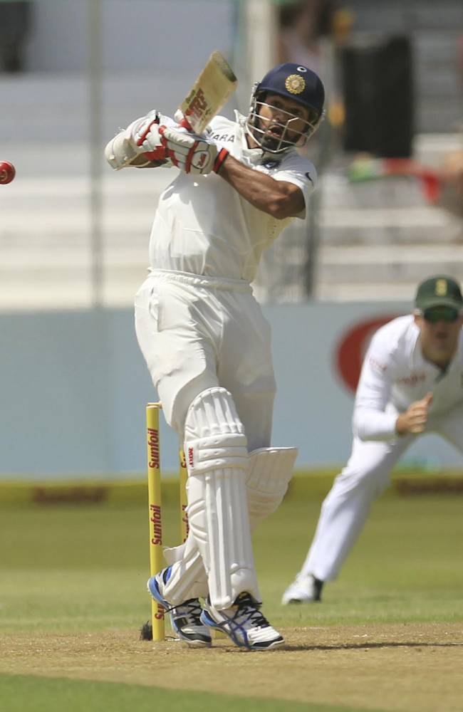 India's batsman Shikhar Dhawan plays a shot during first day of their cricket test match against South Africa at Kingsmead stadium, in Durban, South Africa, Thursday, Dec. 26, 2013