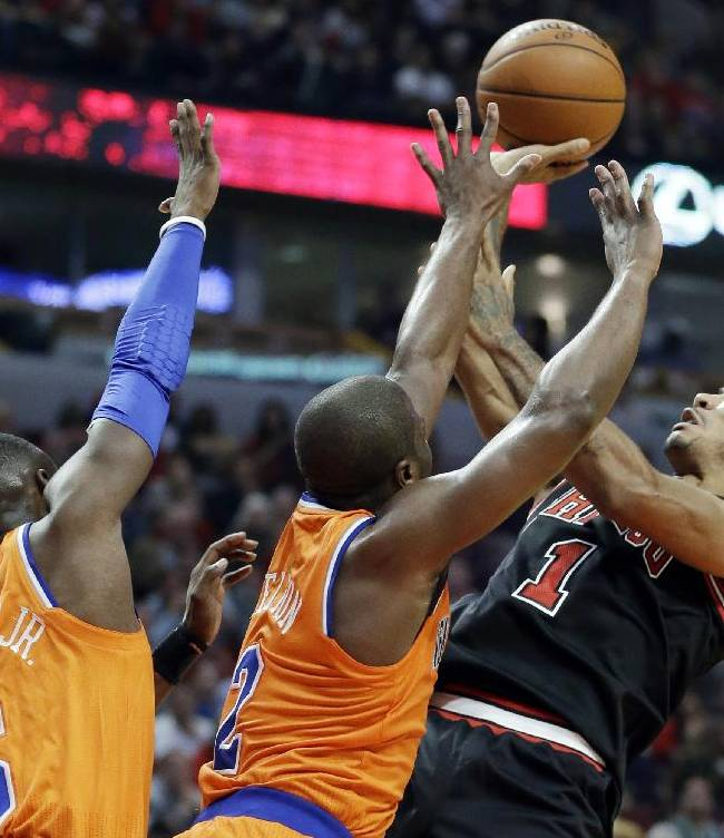 Chicago Bulls guard Derrick Rose (1) shoots over New York Knicks guard Raymond Felton (2) and guard Tim Hardaway Jr during the second half of an NBA basketball game in Chicago, Thursday, Oct. 31, 2013. The Bulls won 82-81
