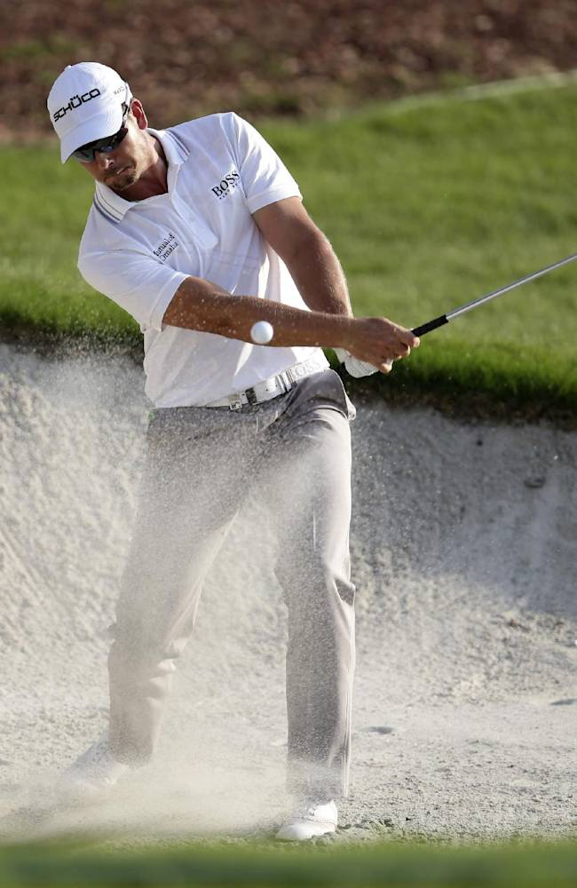Henrik Stenson from Sweden plays a bunker shot during the 3rd round of the World Tour Golf Championship in Dubai, United Arab Emirates, Saturday, Nov. 16, 2013