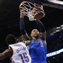 Dallas Mavericks forward Shawn Marion (0) dunks in front of Oklahoma City Thunder guard Reggie Jackson (15) in the second quarter of an NBA basketball game in Oklahoma City, Sunday, March 16, 2014 The Associated Press