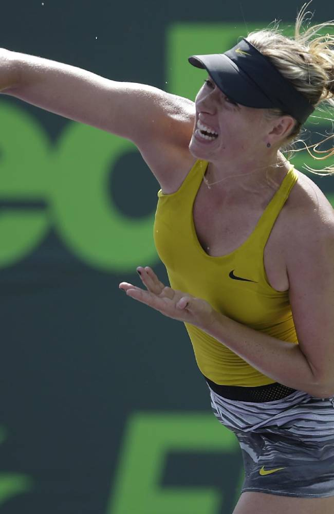 Maria Sharapova, of Russia, serves to Kirsten Flipkens, of Belgium, at the Sony Open tennis tournament, Monday, March 24, 2014, in Key Biscayne, Fla