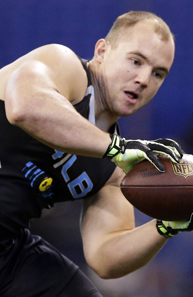 Wisconsin linebacker Chris Borland makes a catch as he runs a drill at the NFL football scouting combine in Indianapolis, Monday, Feb. 24, 2014