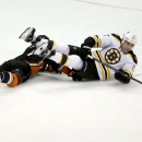 Boston Bruins left wing Milan Lucic, right, battles Anaheim Ducks center Andrew Cogliano for the puck during the second period of an NHL hockey game in Anaheim, Calif., Monday, Dec. 1, 2014 The Associated Press