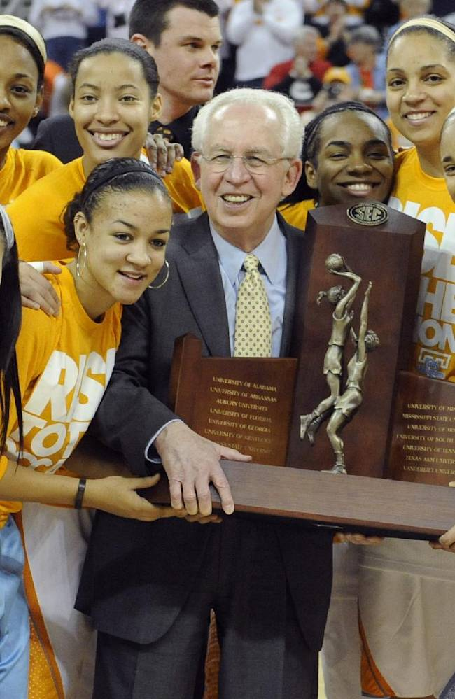 In this March 8, 2013 file photo, Tennessee team members pose with Southeastern Conference Commissioner Mike Slive,  holding their regular season champions trophy before the start of their NCAA college basketball game against Florida in the Southeastern Conference tournament in Duluth, Ga. The Southeastern Conference heads into the 2013-14 season seeking to send a team to the Final Four for the first time since 2008. Tennessee, the defending SEC regular-season champ, may have the best shot at ending the drought