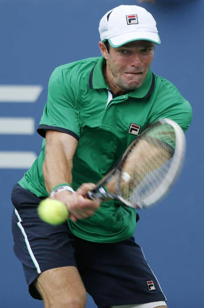 Teymuraz Gabashvili, of Russia, returns a shot against Tomas Berdych, of the Czech Republic, during the third round of the 2014 U.S. Open tennis tournament, Sunday, Aug. 31, 2014, in New York