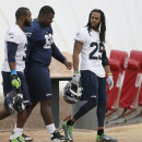 Seattle Seahawks' Richard Sherman (25), Jimmy Stanton, center, and Kam Chancellor (31) arrive for team practice for NFL Super Bowl XLIX football game, Thursday, Jan. 29, 2015, in Tempe, Ariz. The Seahawks play the New England Patriots in Super Bowl XLIX