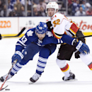 Toronto Maple Leafs forward Nazem Kadri (43) forces his way past Calgary Flames forward Paul Byron (32) during the second period of an NHL hockey game in Toronto on Tuesday, Dec. 9, 2014 The Associated Press