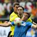 Dortmund's Neven Subotic of Serbia, left, and Hoffenheim's Sven Schipplock challenge for the ball during the German first division Bundesliga soccer match between Borussia Dortmund and TSG 1899 Hoffenheim in Dortmund, Germany, Saturday, May 18, 2013