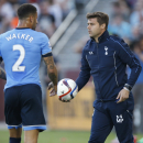 Tottenham Hotspur head coach Mauricio Pochettino, right, confers with defender Kyle Walker while facing the MLS All-Star squad during the first half of the MLS All-Star soccer game Wednesday, July 29, 2015, in Commerce City, Colo. (AP Photo/David Zalubows