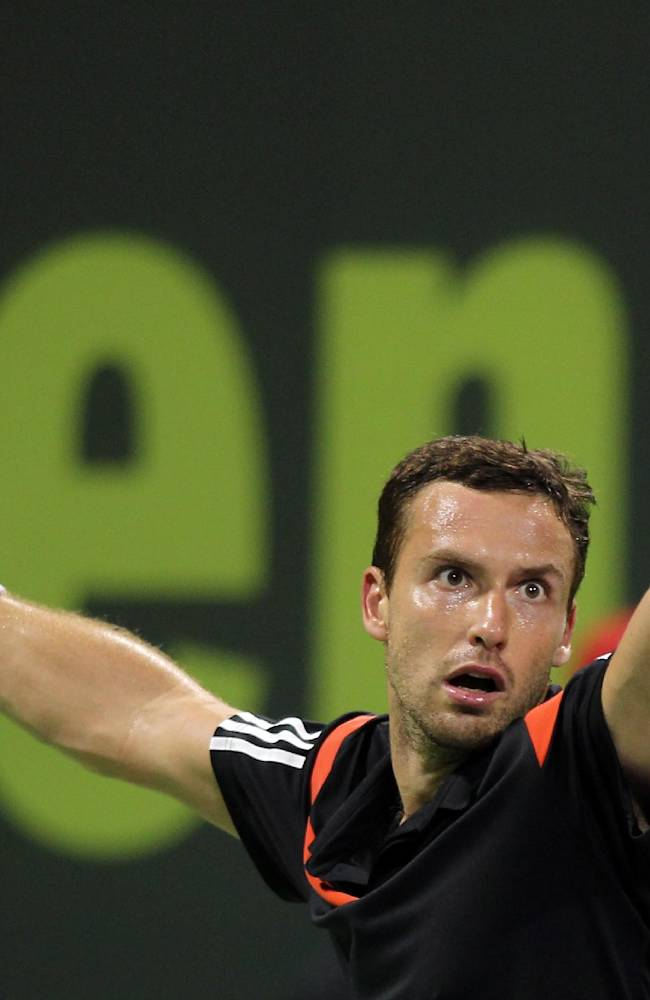 Ernests Gulbis of Latvia returns the ball to Spain's Rafael Nadal during their quarterfinal at the ATP Open tennis tournament at the Khalifa Tennis Complex in Doha, Qatar, Thursday, Jan. 2, 2014