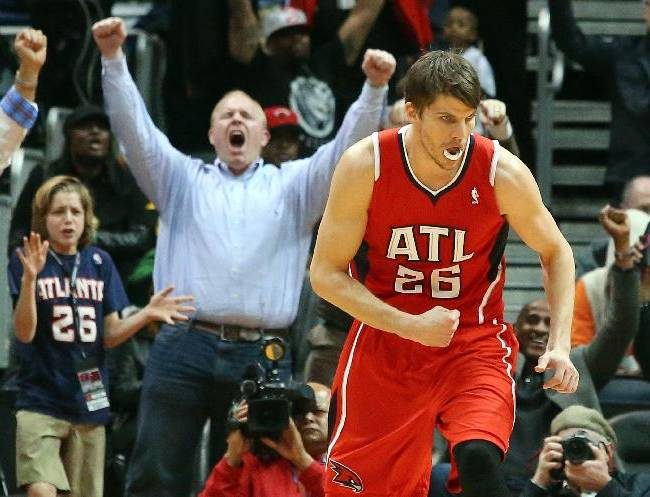 Atlanta Hawks guard Kyle Korver (26) celebrates his 3-pointer that put the Hawks in the lead over the Miami Heat during the second half of an NBA basketball game on Monday, Jan. 20, 2014, in Atlanta