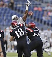 San Diego State quarterback Quinn Kaehler, top, has his pass knocked down by Nevada defensive lineman Rykeem Yates during the first quarter of an NCAA college football game on Friday, Oct. 4, 2013, in San Diego. (AP Photo/Lenny Ignelzi)