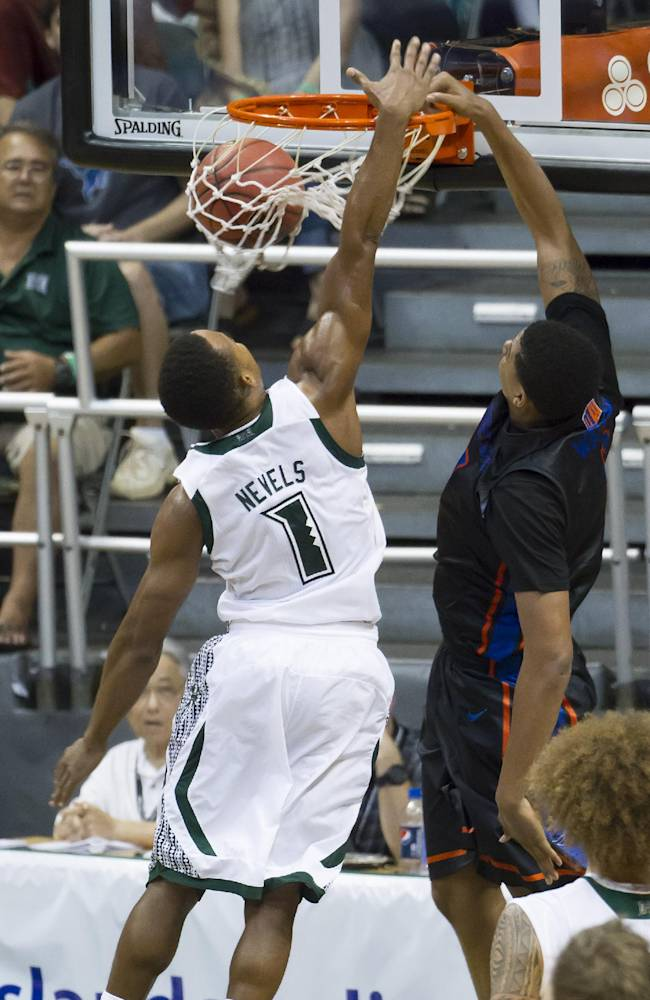 Boise State forward Ryan Watkins, right, dunks the basketball while being defended by Hawaii guard Garrett Nevels (1) in the second half of an NCAA college basketball game at the Diamond Head Classic Sunday, Dec. 22, 2013, in Honolulu. Boise State beat Hawaii 62-61