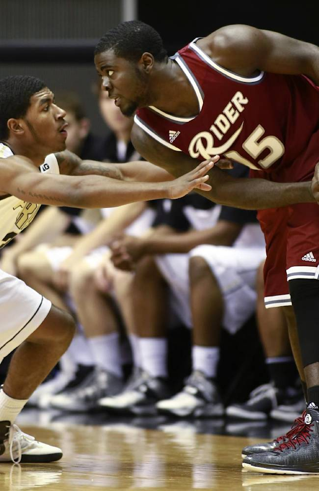 Purdue guard Ronnie Johnson, left, defends Rider guard Khalil Alford in the first half of an NCAA basketball game in West Lafayette, Ind., Sunday, Nov. 17, 2013