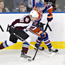 Colorado Avalanche's Gabriel Landeskog (92) and Edmonton Oilers' Justin Schultz (19) battle for the puck during second-period NHL hockey game action in Edmonton, Alberta, Thursday, Dec. 5, 2013 The Associated Press