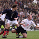 FILE- In this Saturday, Nov. 13 1999 file photo, England's soccer captain Alan Shearer, right, in action against Scotland's Christian Dailly at Glasgow's Hampden Park, Scotland, during their soccer Euro 2000 qualifier, which England won 2-0. In international football, few rivalries are greater none are older than England vs. Scotland. So fierce was the rancor, that a quarter of a century ago, facing a losing battle against rampant hooliganism, their annual matches had to be abandoned. The only encounters since 1989 have been in official competitions, with the neighbors facing off at the 1996 European Championship in London, and home and away three years later in a Euro 2000 playoff. Wembley Stadium on Wednesday, Aug. 14, 2013 will host the 111th meeting between England and Scotland since the first in 1872. (AP Photo/Max Nash, File)