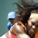 FILE - In this March 30, 2015, file phota, Serena Williams returns the ball to Svetlana Kuznetsova during their match at the Miami Open tennis tournament in Key Biscayne, Fla. The top-ranked player could face quite a challenge this weekend, though, when she may have to play three matches in two days before a hostile crowd on slow red clay against Italy in a Fed Cup World Group playoff. Besides playing two singles matches in the best-of-five series, Fernandez said Serena will also be expected to play doubles if the match is tied 2-2 Sunday. (AP Photo/J Pat Carter, File)