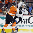 Philadelphia Flyers' Brayden Schenn (10), left, checks Colorado Avalanche's Jarome Iginla (12), right, into the boards in the third period of an NHL hockey game, Saturday, Nov. 8, 2014, in Philadelphia. The Flyers won 4-3 The Associated Press