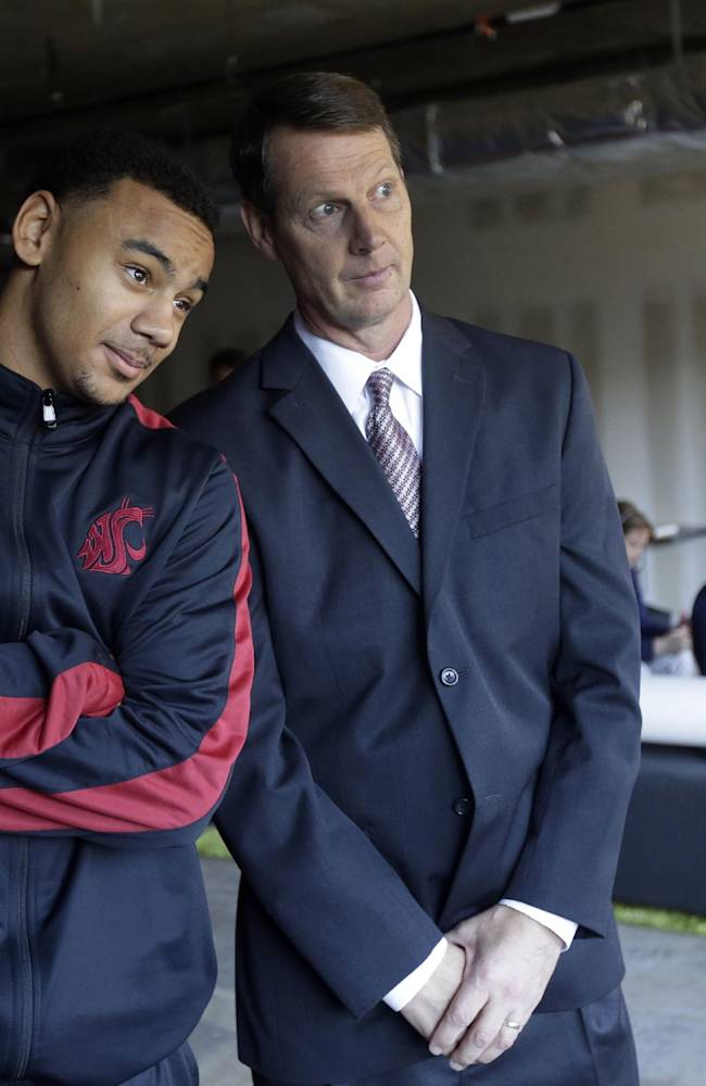 Washington State's Davonte Lacy, left, and head coach Ken Bone jokingly pose for a photographer during the Pac-12 NCAA college basketball media day on Thursday, Oct. 17, 2013, in San Francisco