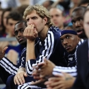 Dallas Mavericks' forward Dirk Nowitzki, second left, watches his teammates during an exhibition basketball game against FC Barcelona in Barcelona, Spain, Tuesday, Oct. 9, 2012. (AP Photo / Manu Fernandez)