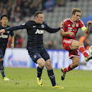 Bayern's Philipp Lahm , right, clears the ball from Manchester United's Wayne Rooney during the Champions League quarterfinal second leg soccer match between Bayern Munich and Manchester United in the Allianz Arena in Munich, Germany, Wednesday, April 9,