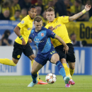 Dortmund's Ciro Immobile, right, and Arsenal's Jack Wilshere challenge for the ball during the Champions League group D soccer match between Borussia Dortmund and Arsenal in Dortmund, Germany, Tuesday, Sept.16,2014