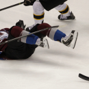 Colorado Avalanche center Matt Duchene (9) falls to the ice in the third period of an NHL hockey game against the Boston Bruins in Denver on Friday, March 21, 2014. Boston won 2-0 The Associated Press