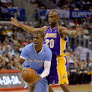 Los Angeles Clippers guard Chris Paul (3) yells for assistance as Los Angeles Lakers guard Jodie Meeks (20) pressures him in the first half of an NBA basketball game on Sunday, April 6, 2014, in Los Angeles The Associated Press