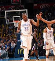 OKLAHOMA CITY, OK - MARCH 28: Kevin Durant #35 of the Oklahoma City Thunder celebrates during a game against the Sacramento Kings on March 28, 2014 at the Chesapeake Energy Arena in Oklahoma City, Oklahoma. (Photo by Layne Murdoch/NBAE via Getty Images)