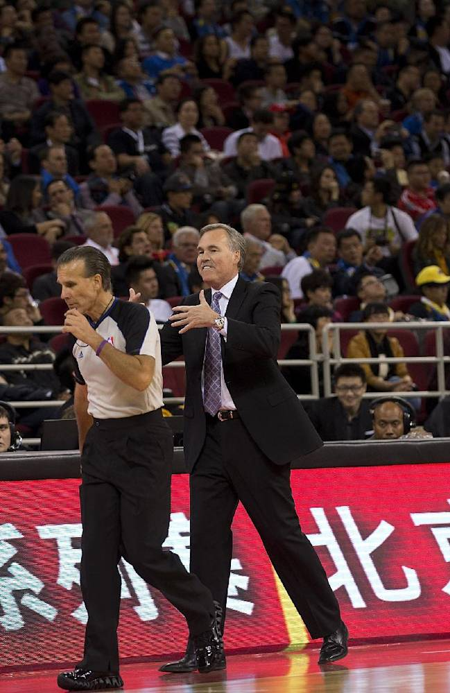 LA Lakers head coach Mike D'Antoni, right, gestures as he speaks to a referee during is team play with Golden State Warriors during the NBA Global Game with LA Lakers at the Wukesong Stadium in Beijing, Tuesday, Oct. 15, 2013. The Warriors defeated Lakers 100-95