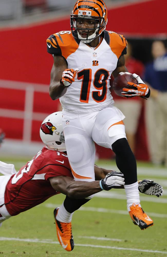 Cincinnati Bengals wide receiver Brandon Tate (19) is tackled by Arizona Cardinals' Jaron Brown (13) during the first half of an NFL preseason football game, Sunday, Aug. 24, 2014, in Glendale, Ariz