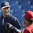New York Yankees shortstop Derek Jeter, left, chats with former teammate and current Philadelphia Phillies designated hitter Bobby Abreu, center, before a spring exhibition baseball game between their two teams in Tampa, Fla., Tuesday, March 25, 2014 The