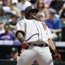 San Francisco Giants' Pablo Sandoval reacts after being called out on strikes against the Colorado Rockies to close out the top of the first inning of a baseball game in Denver on Sunday, May 19, 2013. (AP Photo/David Zalubowski)
