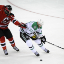 New Jersey Devils' Adam Henrique, left, hooks Dallas Stars' Alex Goligoski during the third period of an NHL hockey game Friday, Oct. 24, 2014, in Newark, N.J. Henrique received a penalty for hooking. The Stars won 3-2 in a shootout The Associated Press