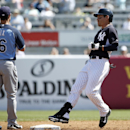 New York Yankees center fielder Jacoby Ellsbury pulls into second on a double as Tampa Bay Rays shortstop Jayson Nix looks toward the outfield in a spring training baseball game in Tampa, Fla., Sunday, March 9, 2014 The Associated Press