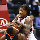 Atlanta Hawks forward Cartier Martin, right, and Charlotte Bobcats forward Michael Kidd-Gilchrist, left, struggle for control of the ball in the first half of an NBA basketball game , Monday, April 14, 2014 in Atlanta The Associated Press