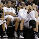 San Antonio Spurs, from left, Tony Parker, of France, Boris Diaw, of France, Tim Duncan, and Manu Ginobili, of Argentina, sit on the bench during the second half on an NBA basketball game against the Indiana Pacers, Saturday, Dec. 7, 2013, in San Antonio